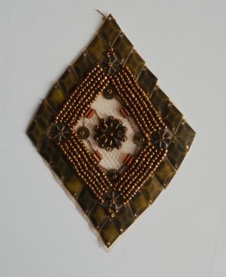 Zierapplikation gold bronze