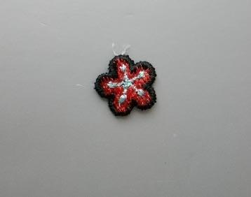 Blume schwarz rot türkis