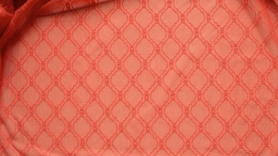 Belegtüll  orange-rot Muster
